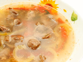 foto of giblets  - appetizing Soup with Chicken giblets in plate over white - JPG