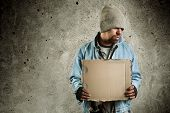 stock photo of scourge  - homeless person selective focus on man and photo f - JPG