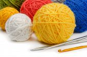 Color wool skeins, knitting needles and crochet