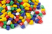 stock photo of raw materials  - Colorful plastic polymer granules on white - JPG