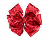 Red dotted silk gift bow isolated on white