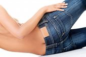 image of bare butt  - Fit female butt in blue jeans - JPG