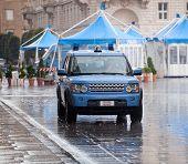 Italian Police Car Under The Rain