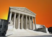 Orange sunset sky over the United States Supreme Court building in Washington DC.