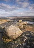 Millstone grit wind shaped boulders on a ridge above a Yorkshire reservoir