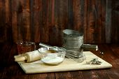 picture of flour sifter  - Baking Ingredients on a Wooden Background - JPG