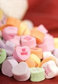 Valentine's Day candy flowing out of a colorful container