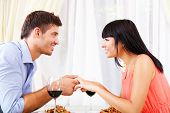 Man proposing engagement ring his woman over restaurant table