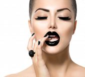 Beauty Fashion Model Girl with Black Make up, Long Lushes. Fashion Trendy Caviar Black Manicure. Nail Art. Dark Lipstick and Nail Polish