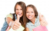 Students Portrait. Cute Young Attractive Teenage Girls Holding Colorful Exercise Books. Thumbs up. I