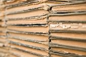 stock photo of annal  - A lot of old worn books are lying on top of each other - JPG