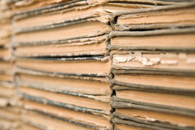 pic of annal  - A lot of old worn books are lying on top of each other - JPG