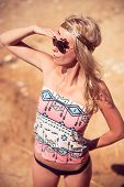 stock photo of hippies  - Pretty young hippie caucasian girl enjoys good weather and the hot sun on a beach - JPG