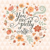 You are pretty. Bright cartoon concept card made of flowers and butterflies. Floral background in pi