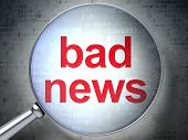 News concept: Bad News with optical glass