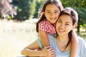 stock photo of 7-year-old  - Portrait Of Asian Mother And Daughter In Countryside - JPG