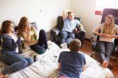Worried Teenage Girl In Bedroom With Boyfriend