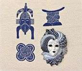stock photo of gobelin  - Venetian mask is on the background of fabric with the image of African mask - JPG