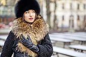 stock photo of ermine  - Winter girl wearing expensive real fur and leather gloves in autumn - JPG