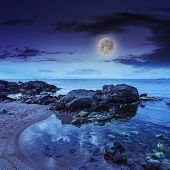 Sea Shore Landscape With Boulders At Night