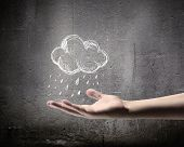 Background conceptual image with raining cloud in hand