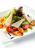 Caesar Salad with Salmon. Comprises Romaine Salad Leaf and Croutons Dressed with Parmesan Cheese