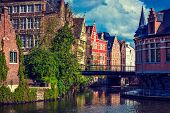 Travel Belgium medieval european city town background with canal. Ghent, Belgium. Retro vintage hips