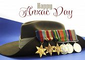 image of army  - Australian army slouch hat with World War II campaign medals with Happy Anzac Day sample text or copy space or D - JPG