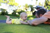 Cute Baby Is Playing With Father