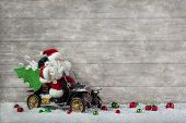 Christmas Decoration: Red Santa Claus In Hurry To Buy Christmas Presents On Wooden Snowy Background.