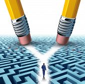 stock photo of solution  - Solution crossroad business concept as a three dimensional maze or labyrinth being erased by two pencils clearing a cross road path for a confused businessman as a symbol for choosing the pathway to success - JPG