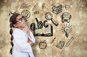 Cute pupil dressed up as scientist against paint splattered paper