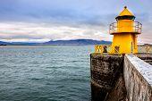 Lighthouse at the entrance to Reykjavik harbor in Iceland