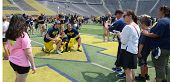 Michigan Football Fans Take Photos On The Field