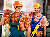 Happy group people men in builder uniform indoor.