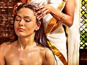 foto of sari  - Young woman having head ayurveda spa treatment - JPG