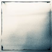 Abstract grained film strip texture. Contains grain, dust and light leaks.