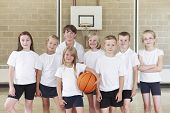 stock photo of pupils  - Portrait Of Pupils In Elementary School Basketball Team