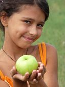 A Beautiful Girl With A Delicious Green Apple
