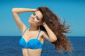 Beautiful Woman Smiling. Summer Portrait Over Seaside And Blue Sky.