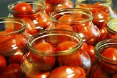 Tasty Tomatoes Ready To Canned In Glass Jar