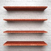 Empty brick shelves on clean red background.