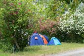 Campsite With Caravan And Tent In Summertime.