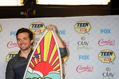 LOS ANGELES - AUG 10:  Ian Harding at the 2014 Teen Choice Awards Press Room at Shrine Auditorium on