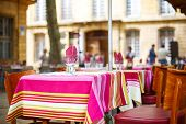 Street View Of A Cafe Terrace With Empty Tables And Chairs, Provence, France