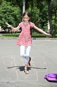 foto of hopscotch  - Cute girl playing hopscotch outside - JPG