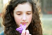 Portrait Of Beautiful Young Girl With Spring Flowers