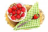 Healthy breakfast - yogurt with  strawberries and muesli served in glass jar, on wooden board, isola