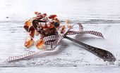 Reed sugar in spoon on wooden background