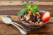 Acai Pulp In Glass Bowl With Strawberry, Muesli And Fresh Mint